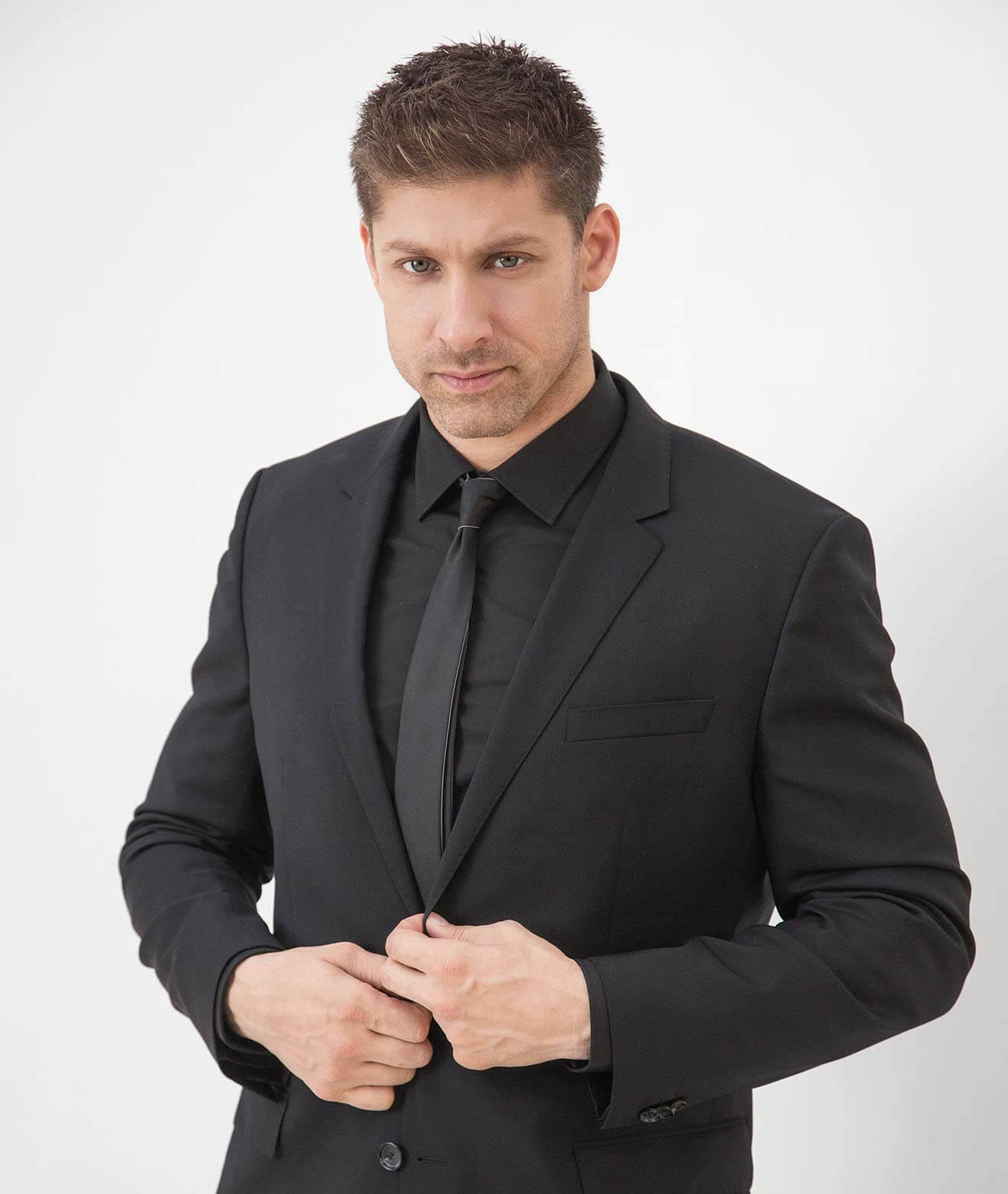 Chillin' with Alain Moussi, black suit, portrait