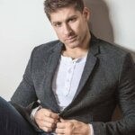 Chillin' with Alain Moussi, sitting in jeans and sport coat, featured image