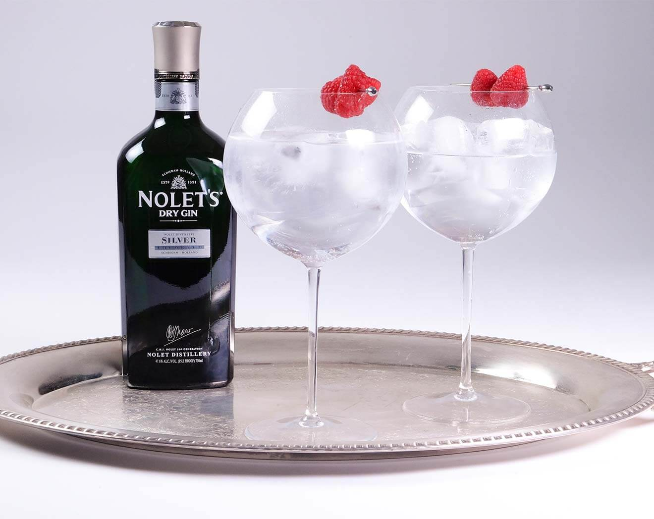 NOLET'S Silver Tonic, bottle and cocktails on silver tray