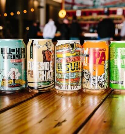 21st Amendment Brewery Lineup, cans on bartop featured image