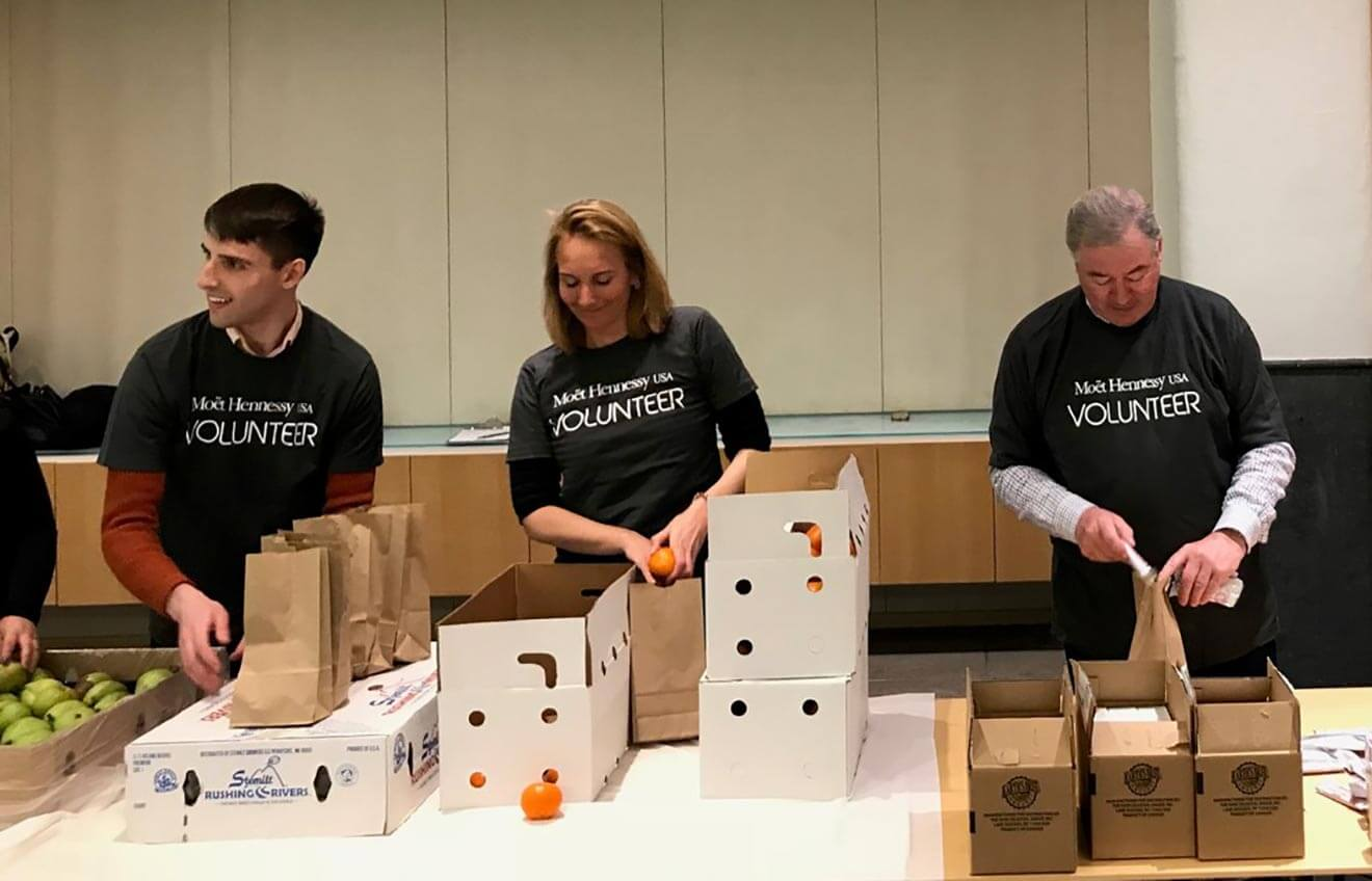 City Harvest Volunteers Packing Boxes