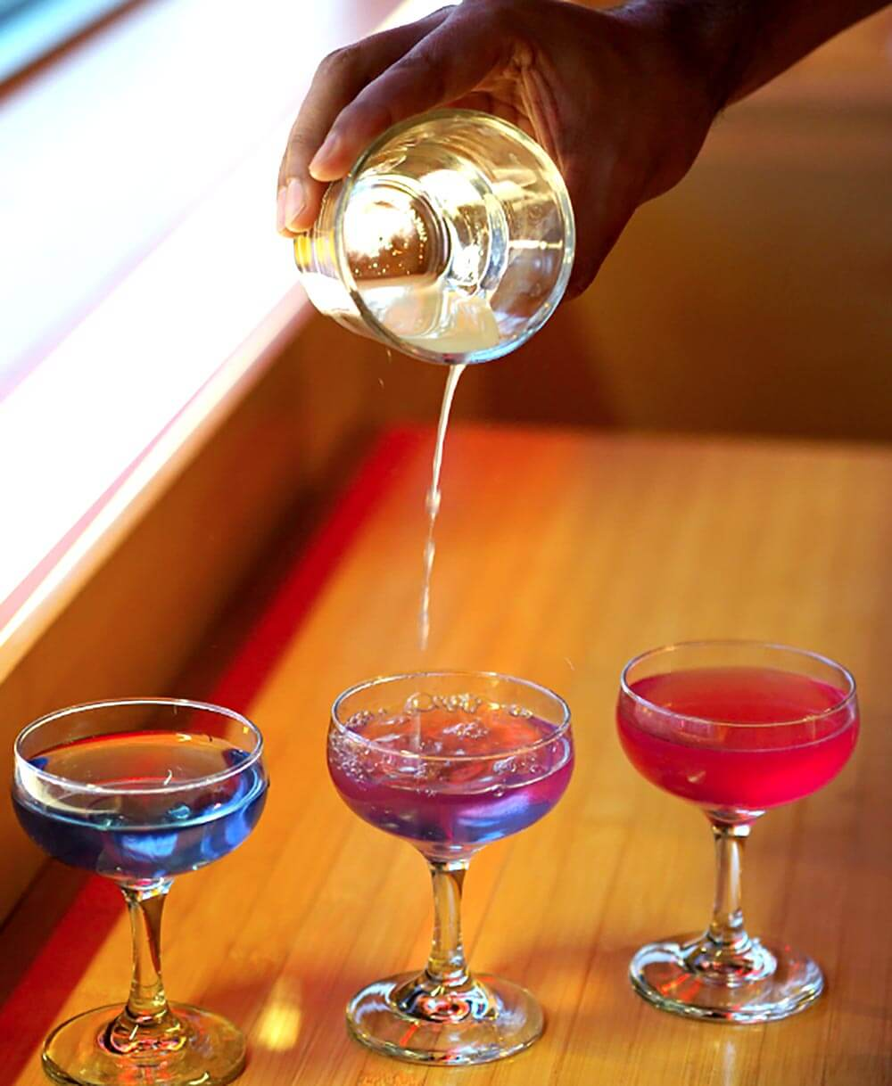 Daikon Color Changing Cocktail, pouring to see color change on table