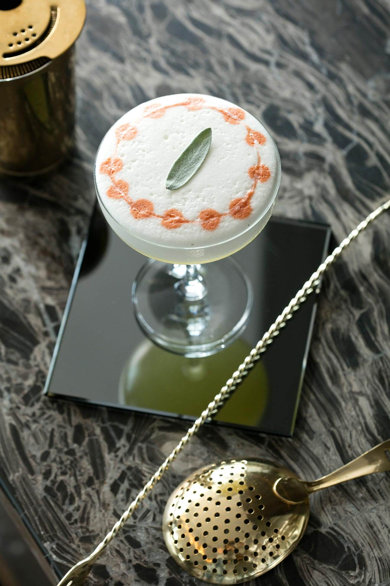 Sage Advice, cocktail with garnish on small plate