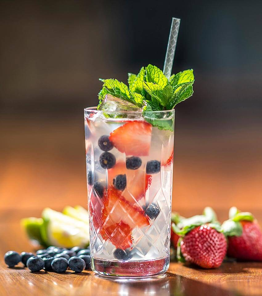 Blueberry and Strawberry Mojito, cocktail and berry garnish