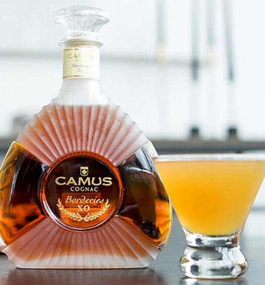 Camus Mango Sidecar, bottle and cocktail on kitchen table, featured image