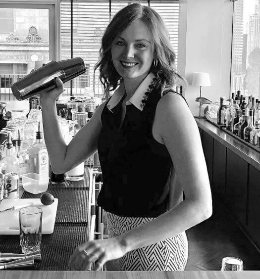 Michelle FitzGerald, black and grey, shaking a cocktail, featured image