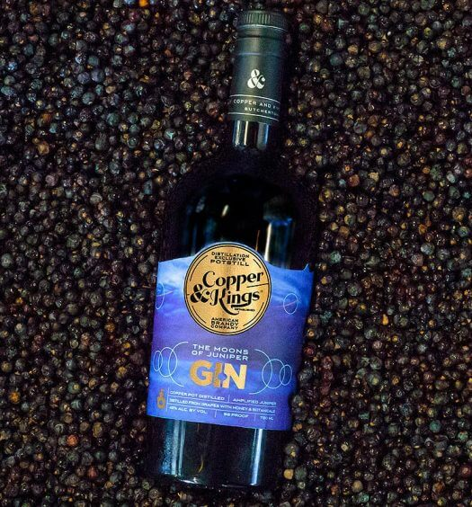 Moons of Juniper Gin, bottle on berries, featured image