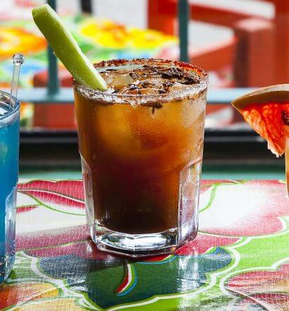 The Mezcal Cocktail Mission, colorful cocktails on display, featured image