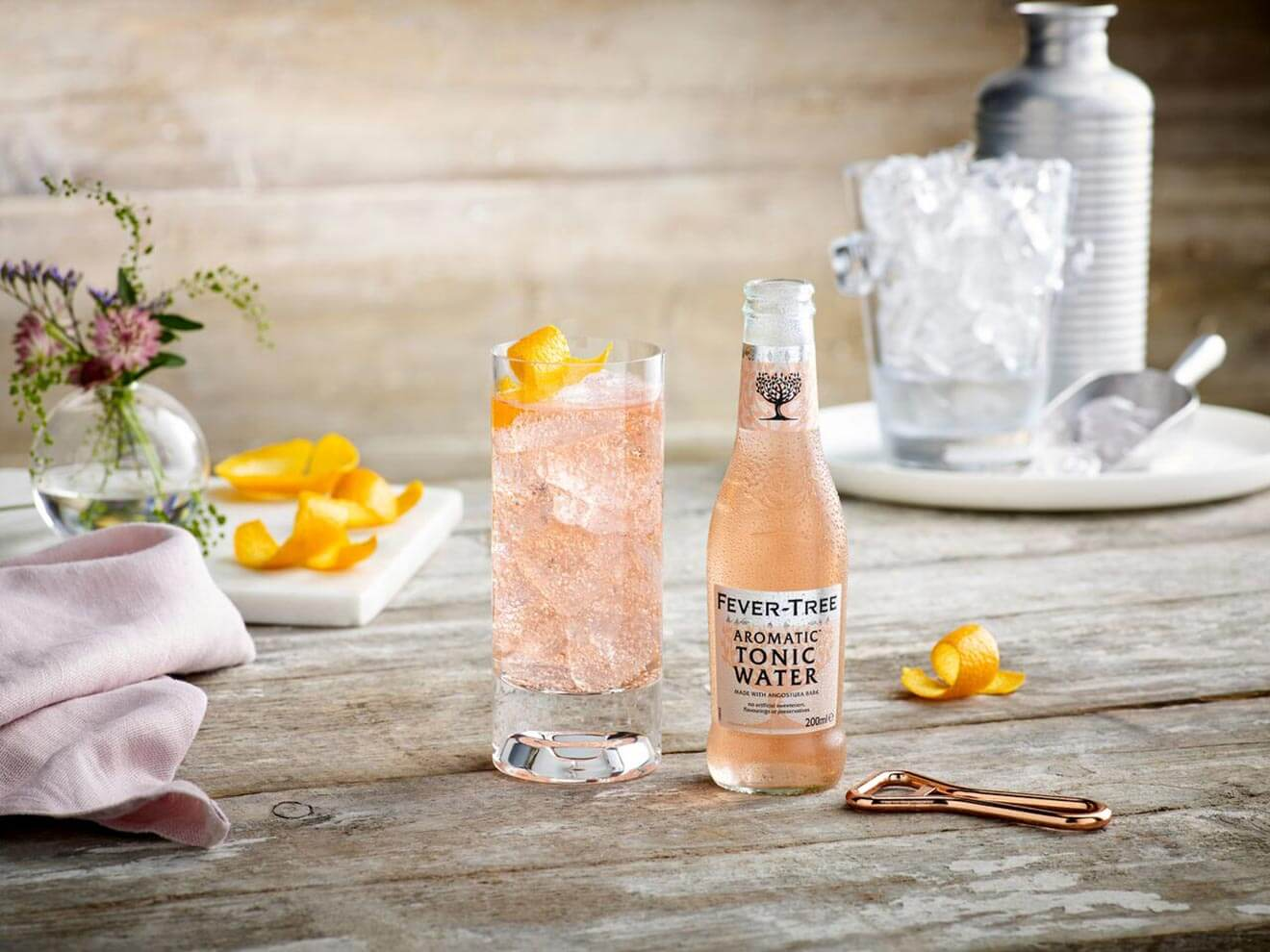 Fever Tree Pink Aromatic Tonic, bottle and glass with garnishes