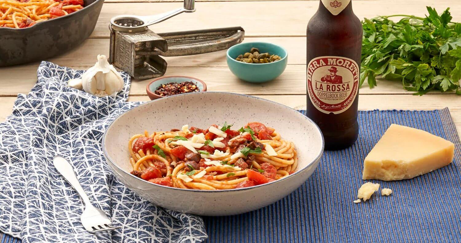 Birra Moretti 'What's More Italian' Summer Program, bottle and dishes display on dining table, garnishes, featured image