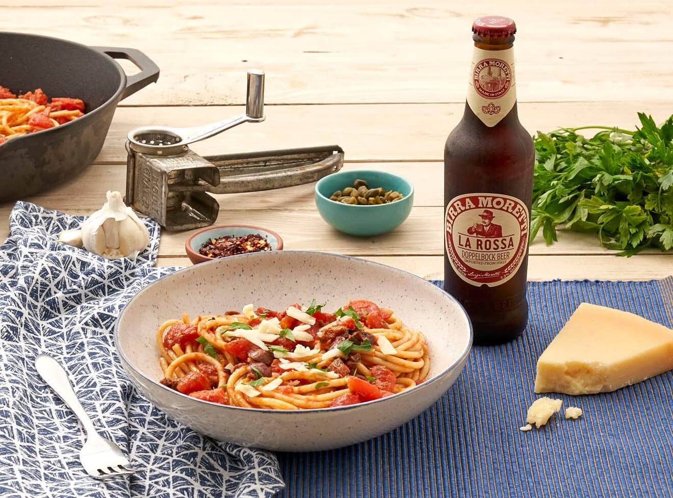 Birra Moretti 'What's More Italian' Summer Program, bottle and dishes display on dining table, garnishes