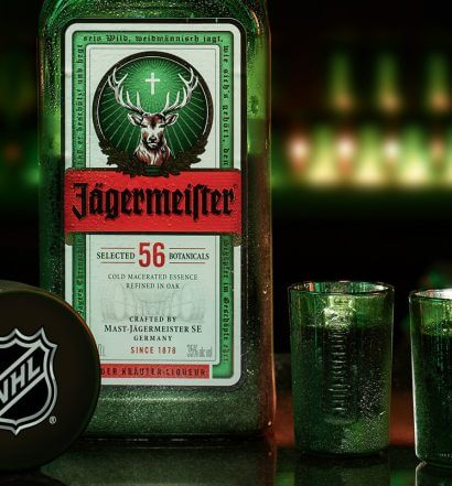 Jägermeister-and-NHL-Announce-Partnership, bottle and shots on the bar, featured image