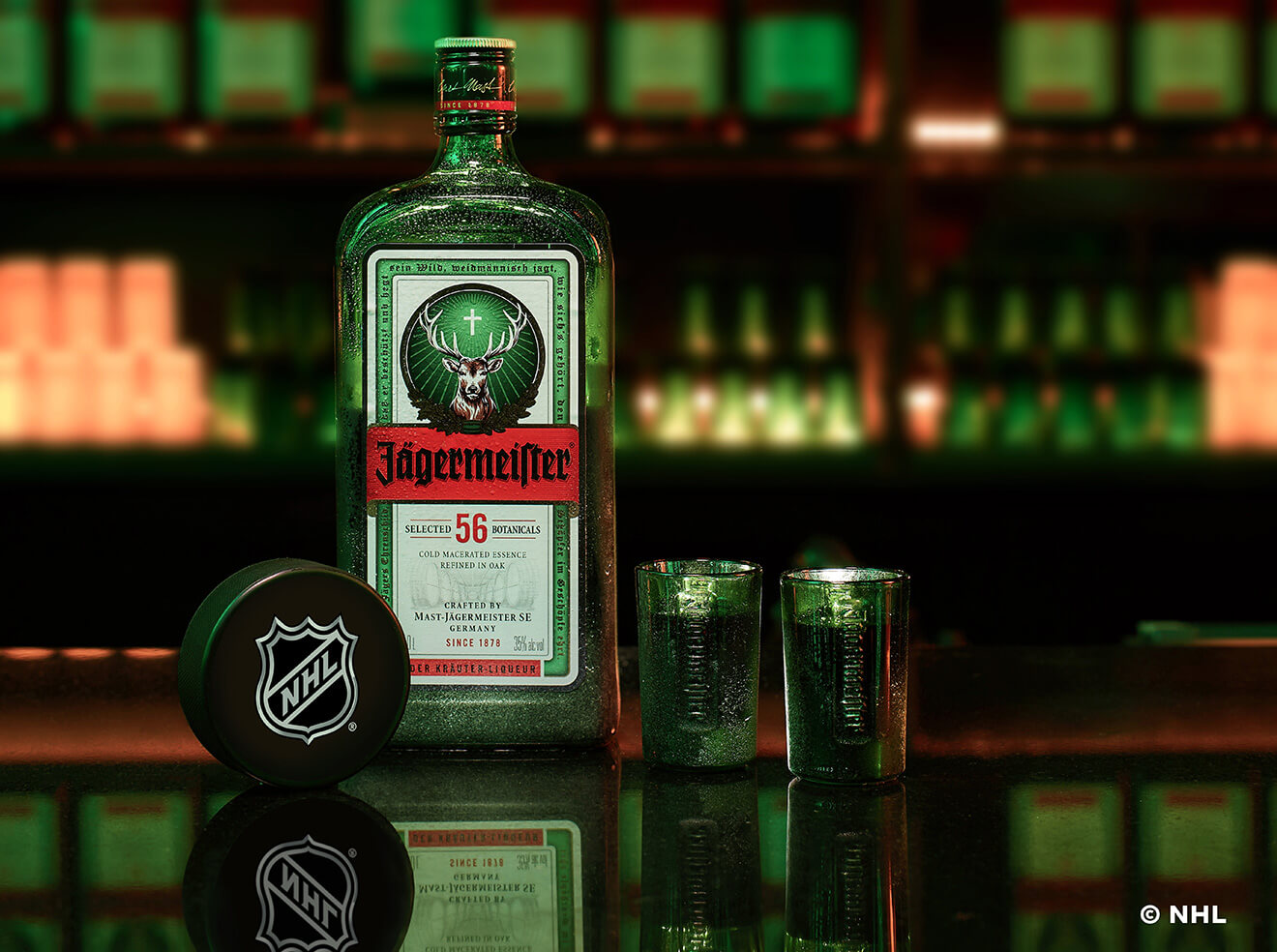 Jägermeister-and-NHL-Announce-Partnership, bottle and shots on the bar