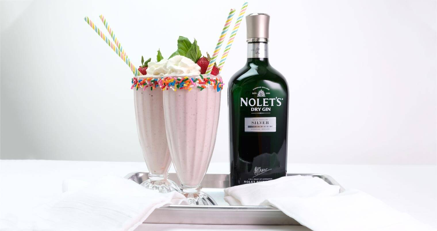 NOLET'S Spiked Strawberry Milkshake, cockails, bottle on silver tray, featured image