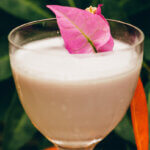 Purple Rain, cocktail with garnish, garden background, featured image