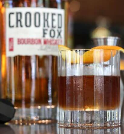 Crooked Fox Bourbon Whiskey, bottle and cocktail, featured image