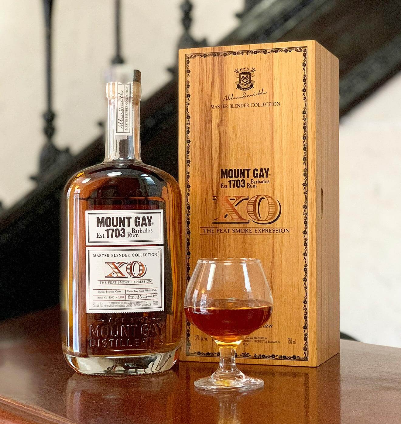 Mount Gay Releases Limited Edition XO The Peat Smoke Expression, bottle, glass and package on table