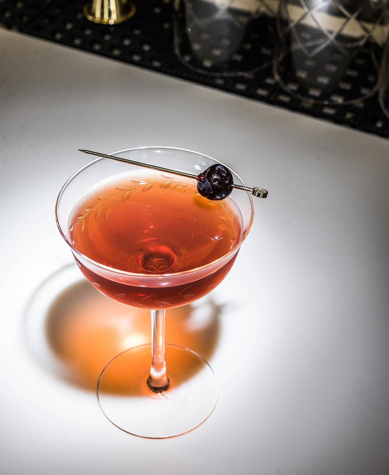 Surfer Rob Roy cocktail with toothipick garnish