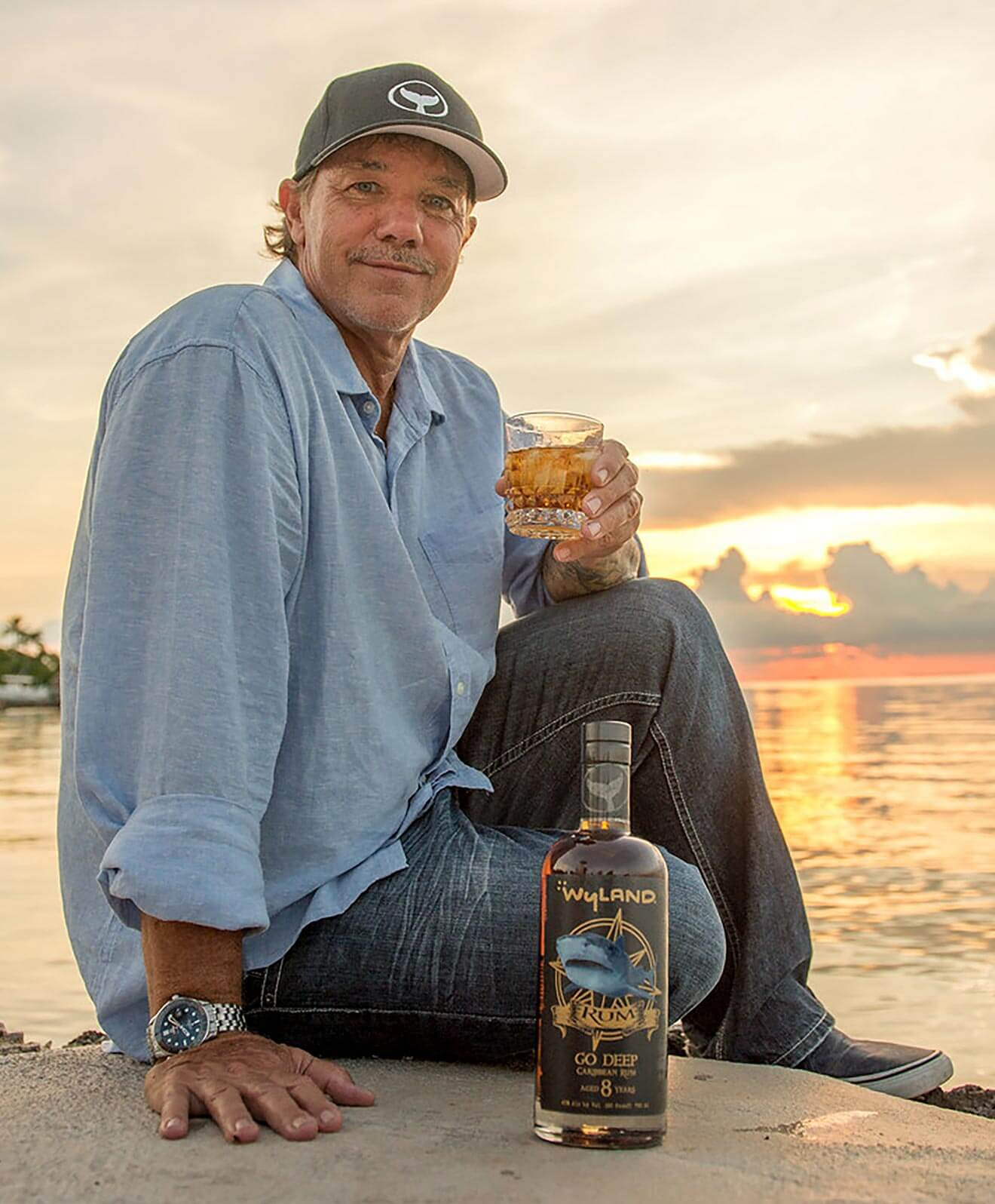 wyland and his new rum, beach and sunset