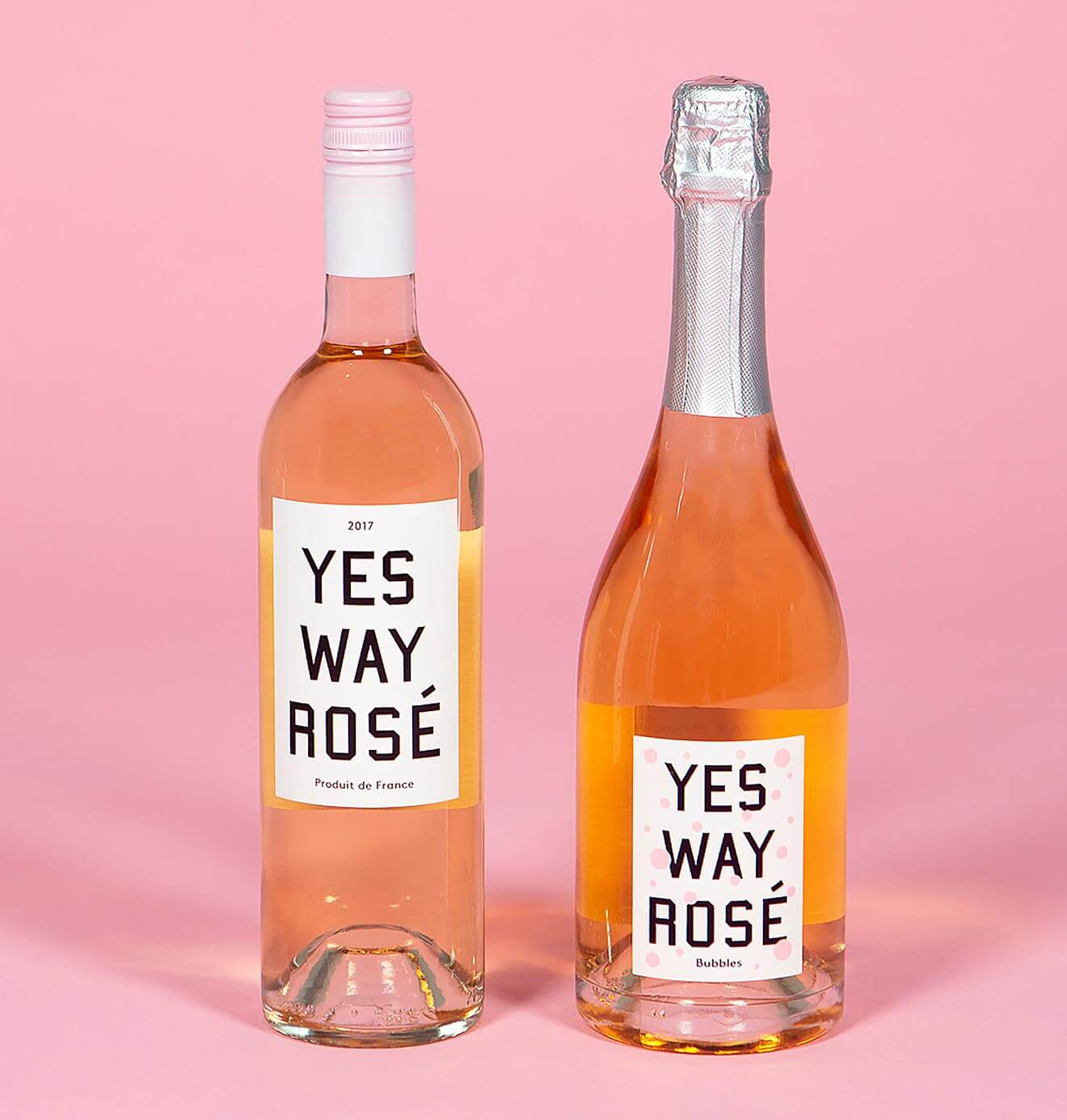 Yes Way Rosé Bubbles, rose and champagne bottles on pink