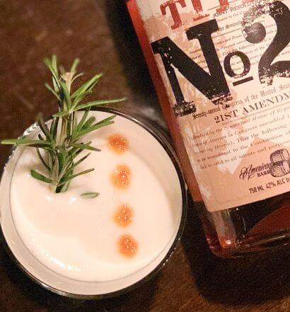 Bourbon Sour, cocktail and bottle, featured image