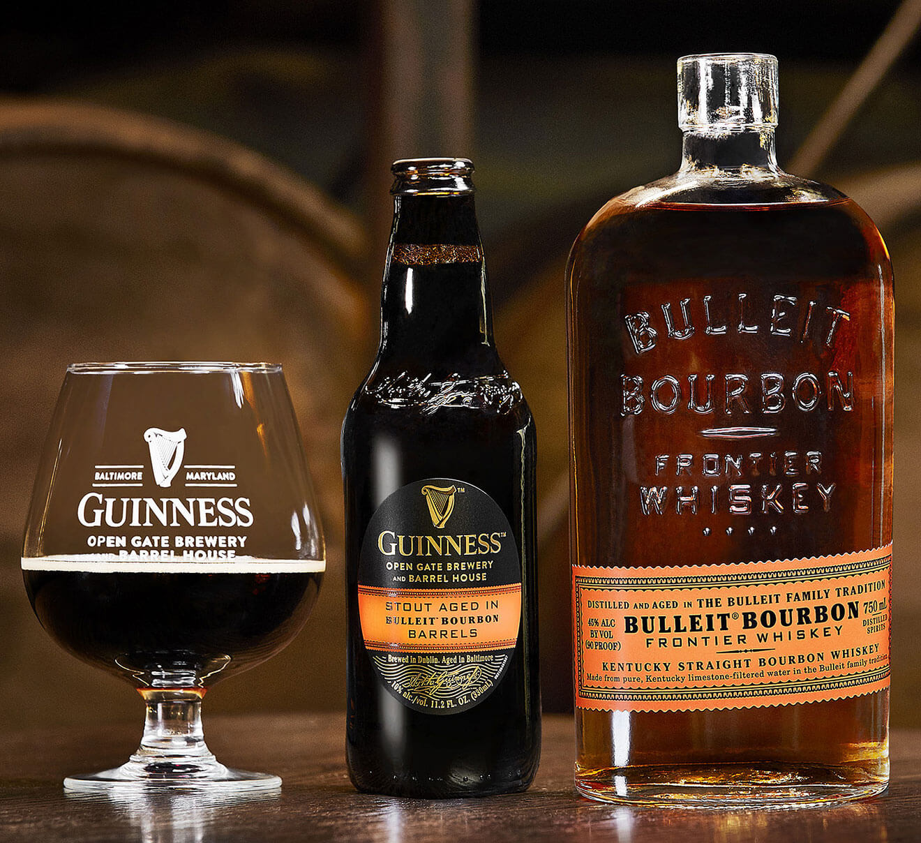 Guinness Barrel-Aged Beer Aged in Bulleit Bourbon Barrels, glass, bottle and bourbon bottle, barrels room