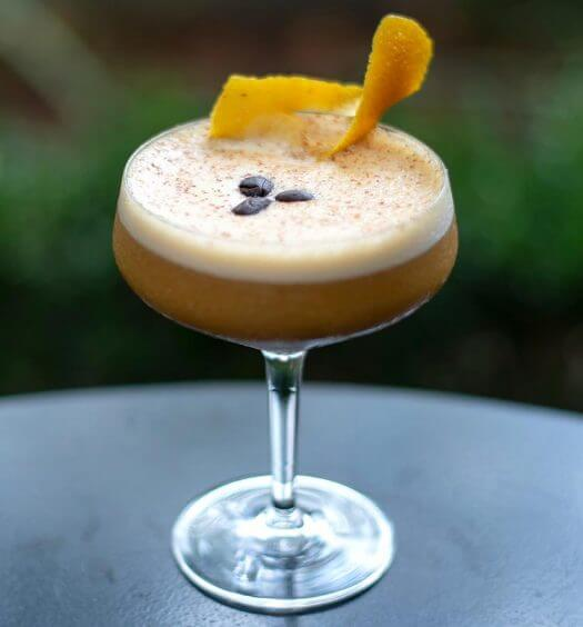 Pumpkin Spiced Latte, cocktail with garnish on table, featured image