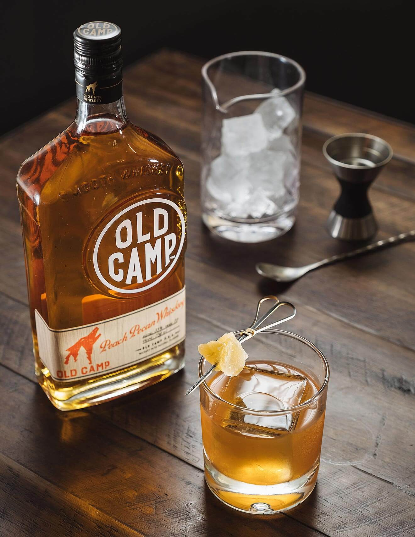 Old Camp Fashioned, bottle and cocktail, ice glass and garnish