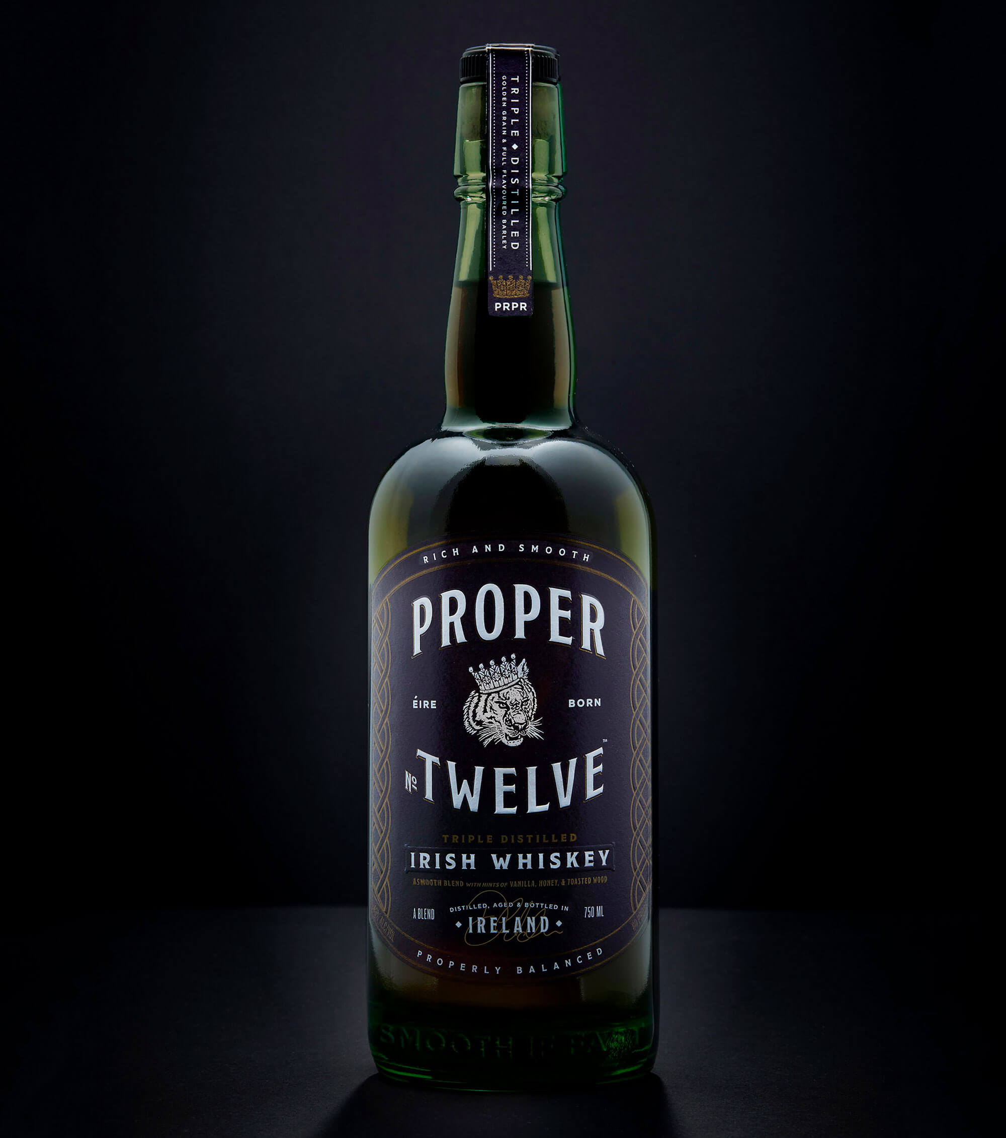 Proper No. Twelve Irish Whiskey, bottle on dark background