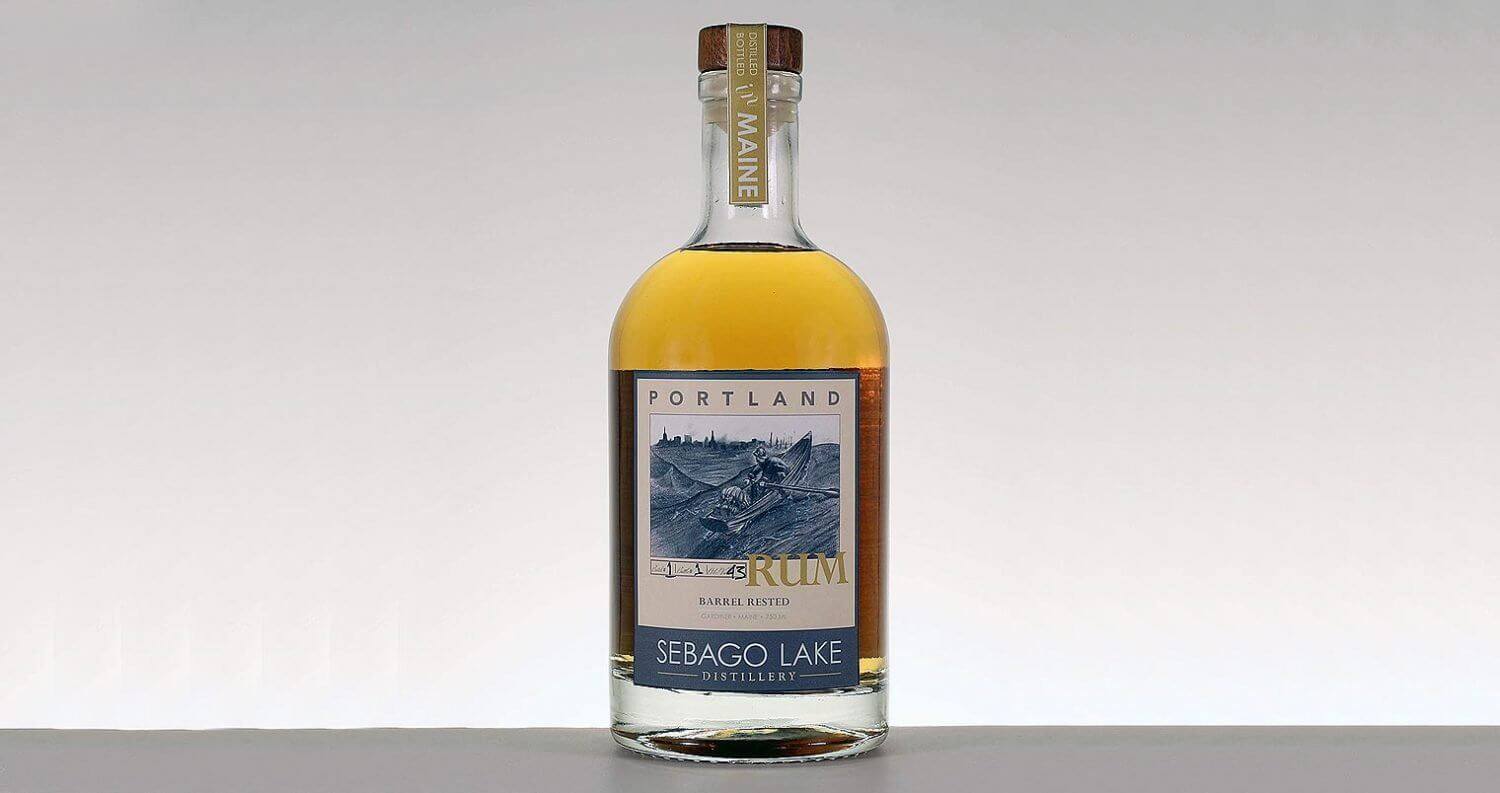 Barrel Rested Portland Rum, bottle on grey back, featured image