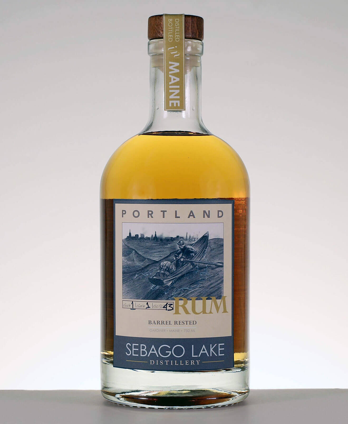 Barrel Rested Portland Rum, bottle on grey background