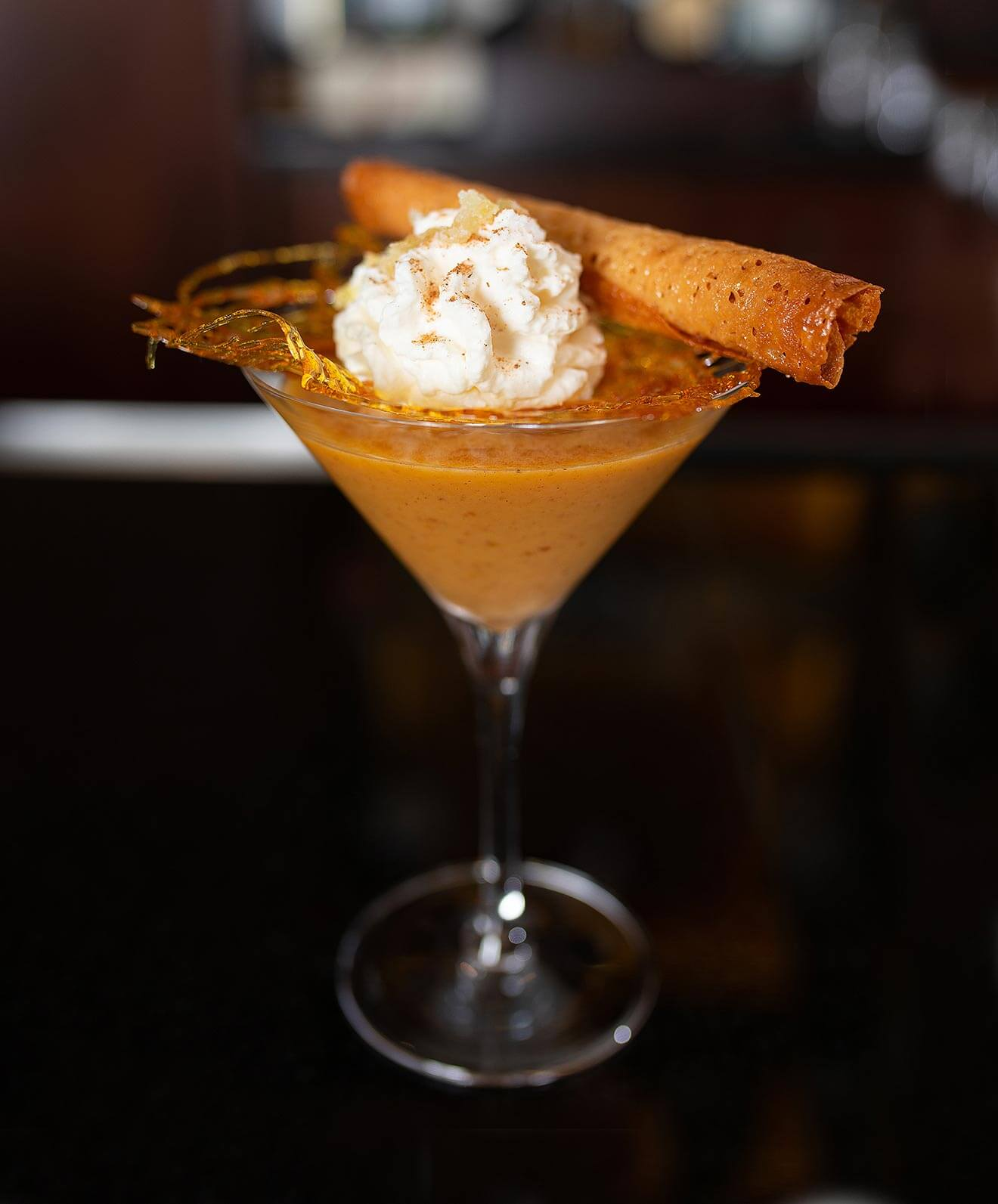 The Great Pocono Pumpkin Spiced Martini, martini cocktailwith garnish and whipped cream