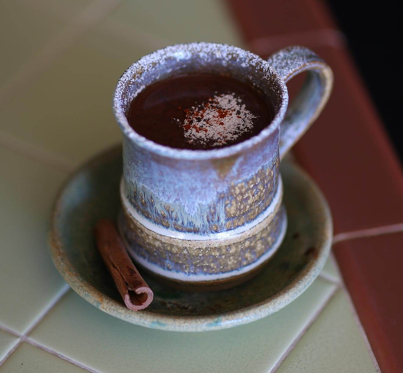 Chocolate Picante cocktail in coffee mug with plate