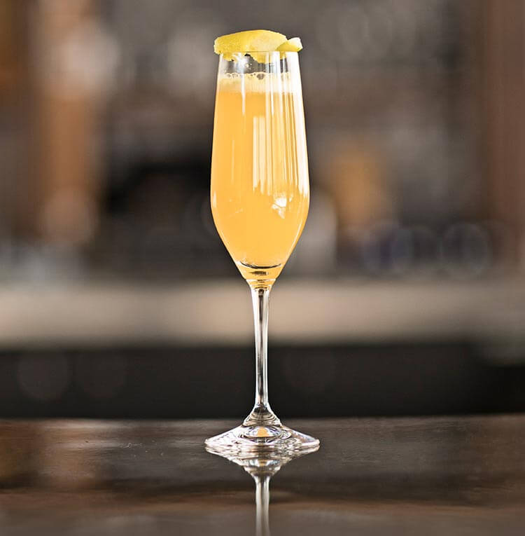Mandarin Mimosa, cocktail on bar table