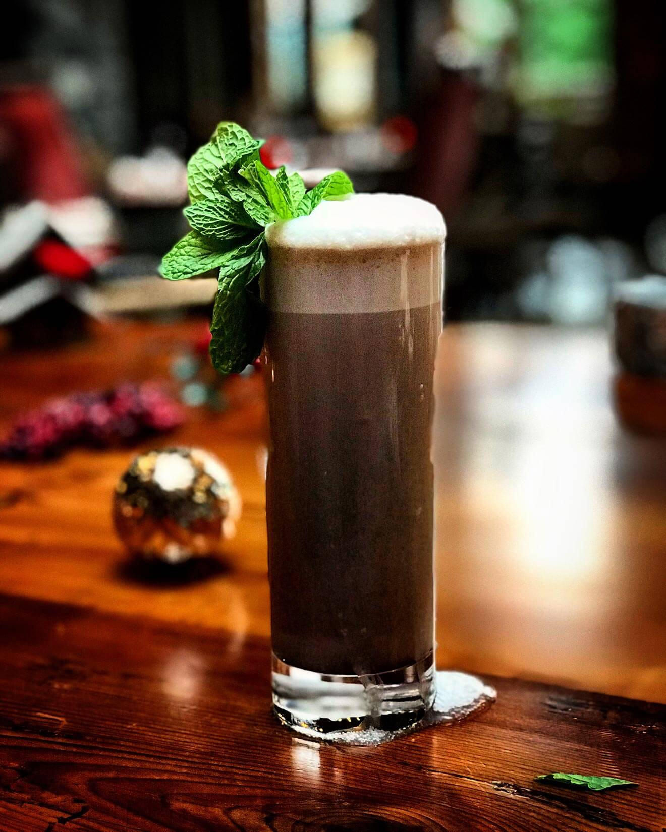 Mint Chocolate Fizz, cocktail with garnish, holiday decorations