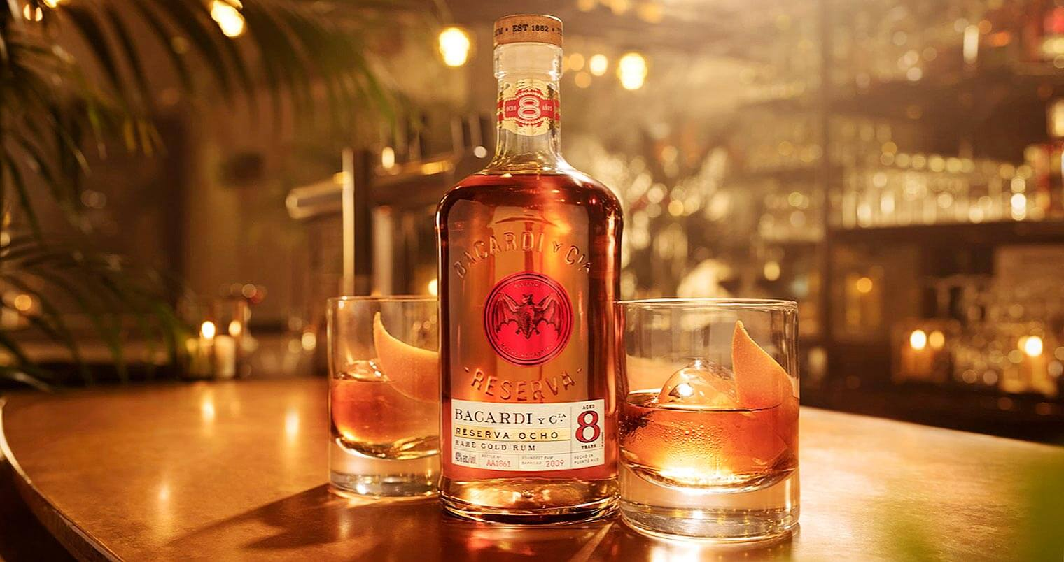 Ocho Old Fashioned, bottle and cocktails on bar table, featured image