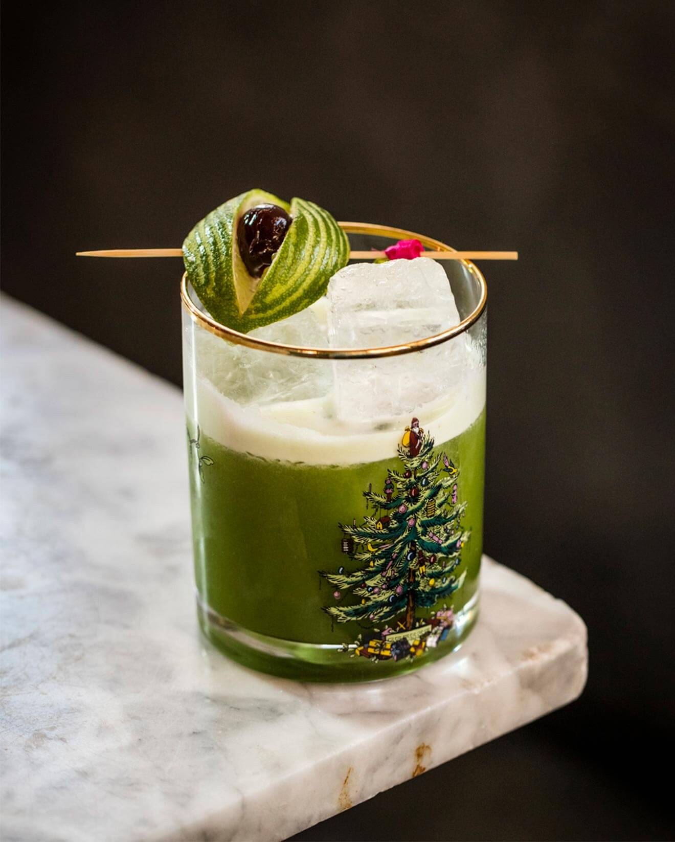 Grinch Don't Kill My Vibe, on marble table corner, cocktail with garnish