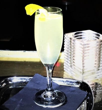 skinny 75 cocktail with garnish on silver tray, featured image