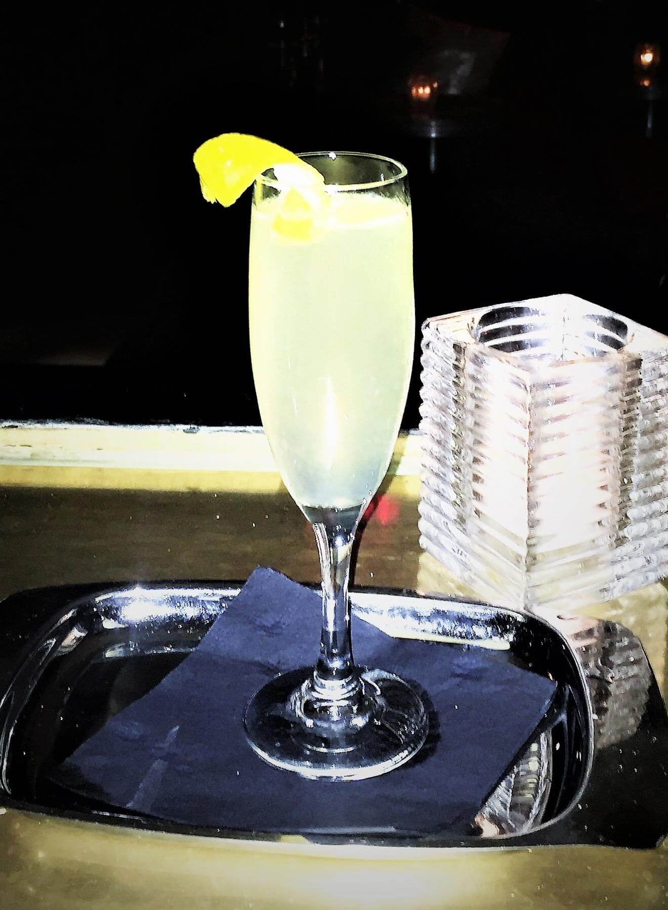 skinny 75 cocktail with garnish on silver tray