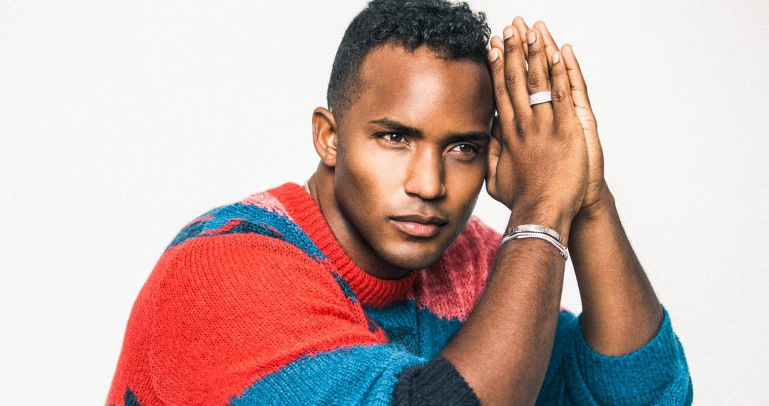 Chillin' with Sterling Sulieman, colorful sweater and pants, featured image