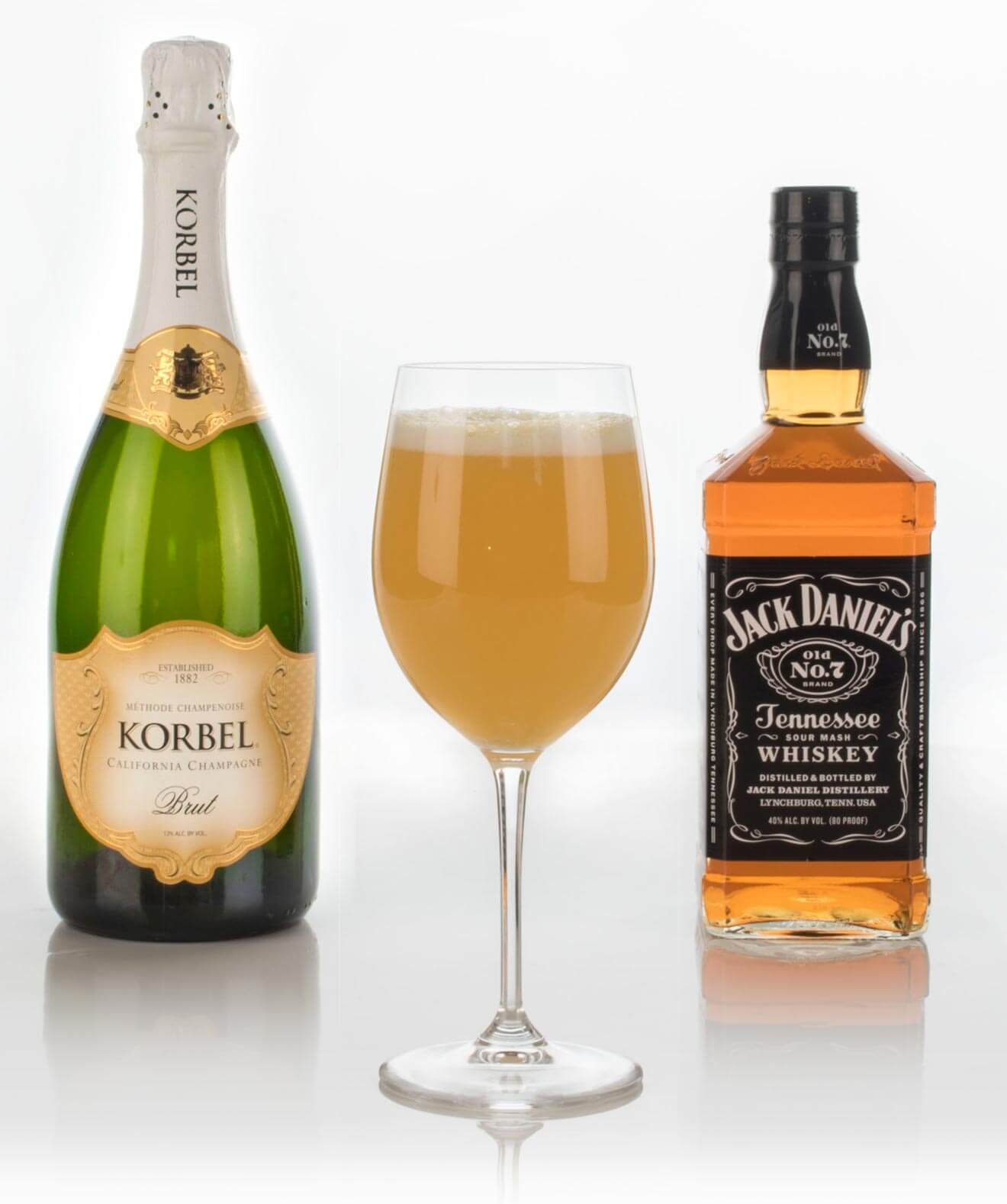 Tennessee Mimosa, cocktail with bottles on white
