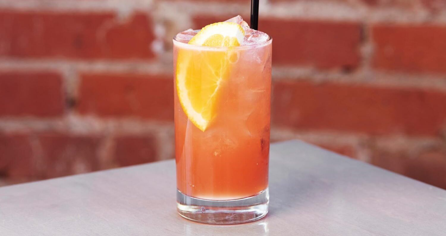 #1 Crush, cocktail with garnish, brick wall, featured image