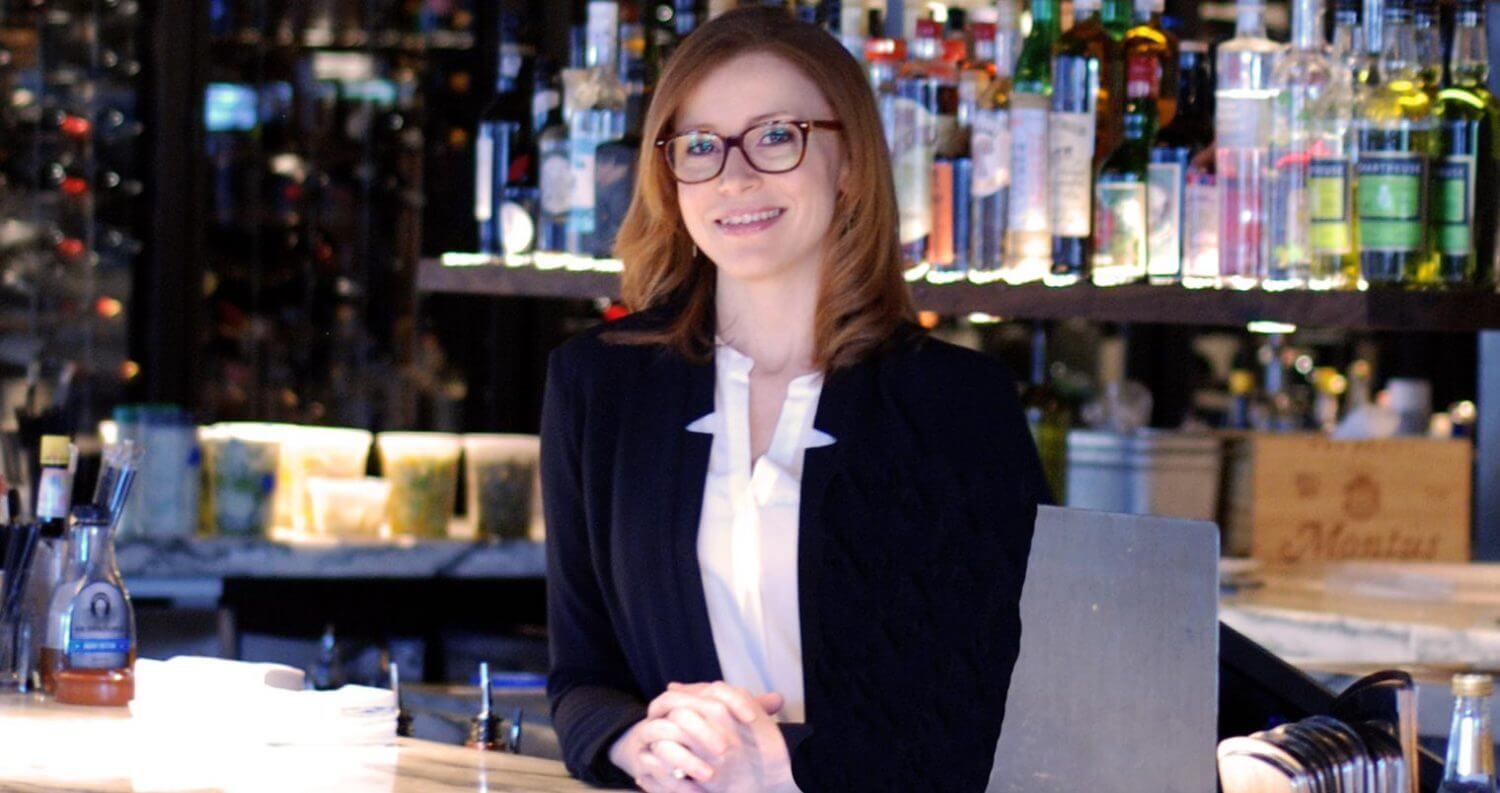 Gretchen Thomas behind the bar, featured image