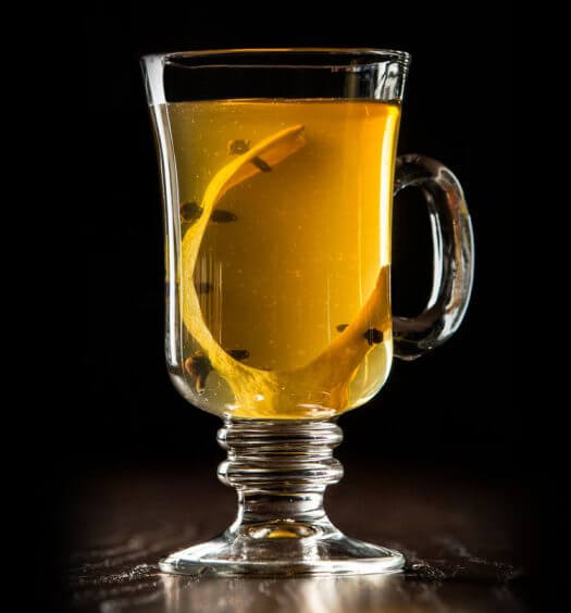 Castle Hot Toddy, cocktail with garnish, dark background, featured image