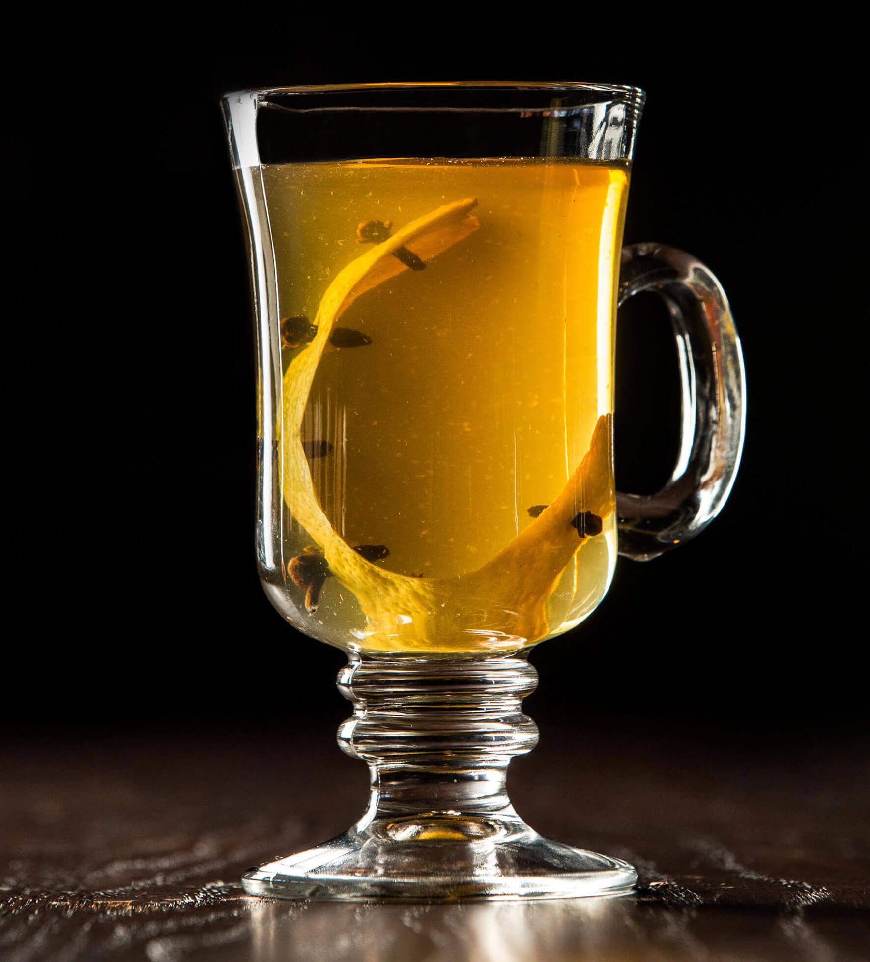 Castle Hot Toddy, cocktail with garnish, dark background