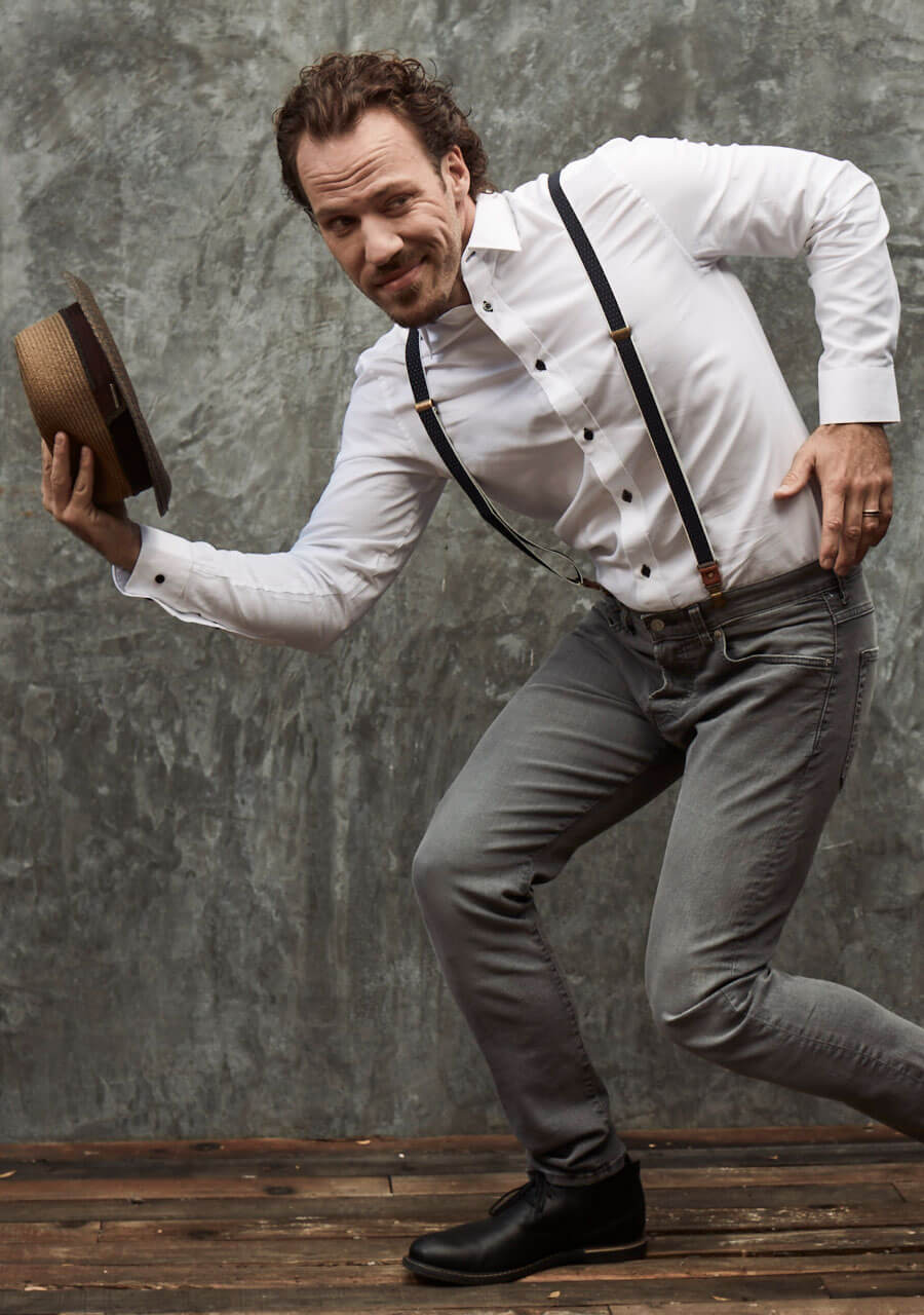 Chillin' with Falk Hentschel, posing with suspenders and hat, dapper