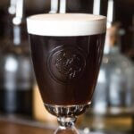 Dead Rabbit Irish Coffee, cocktail on wooden bartop, featured image