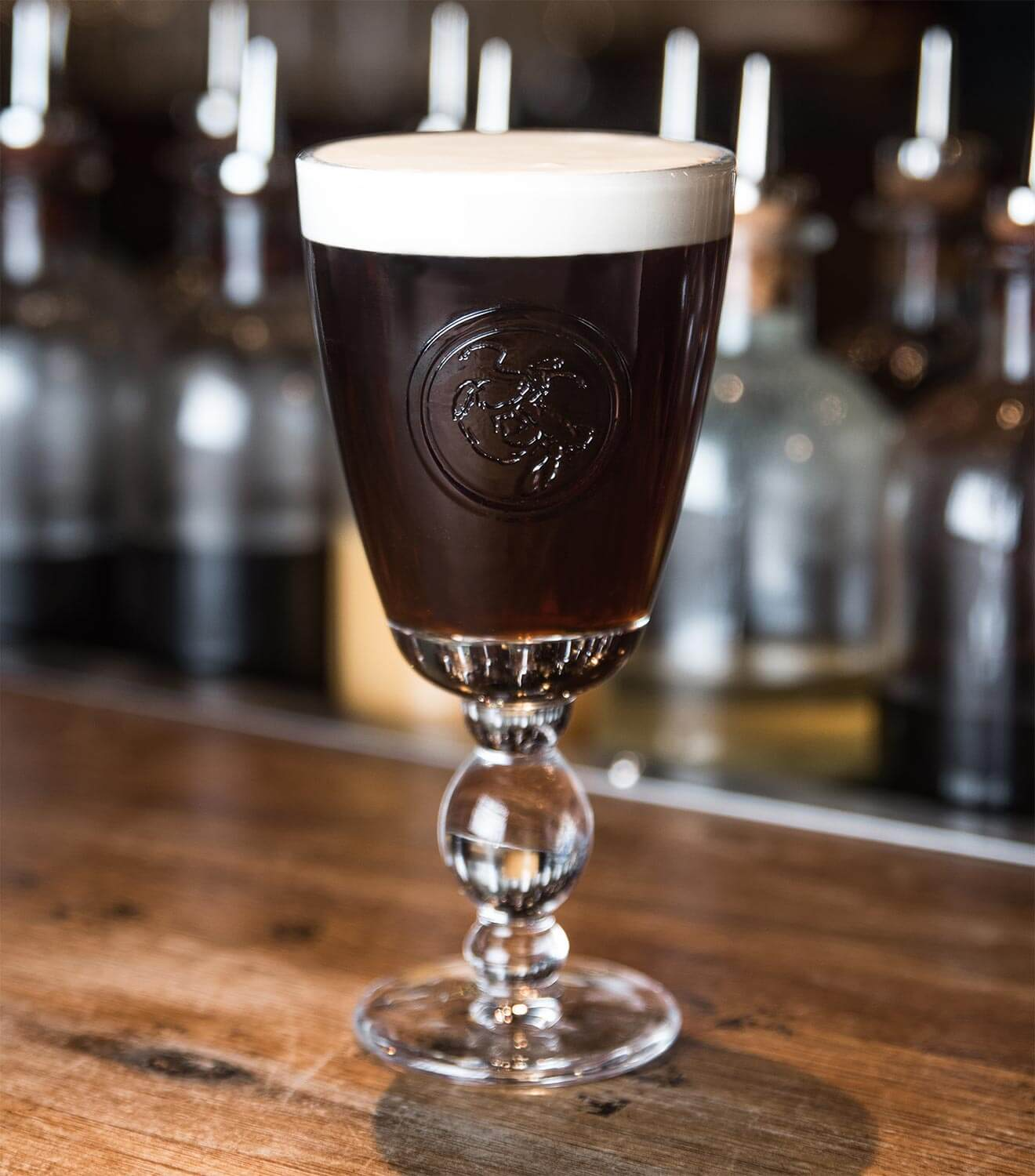 Dead Rabbit Irish Coffee, cocktail on wooden bartop