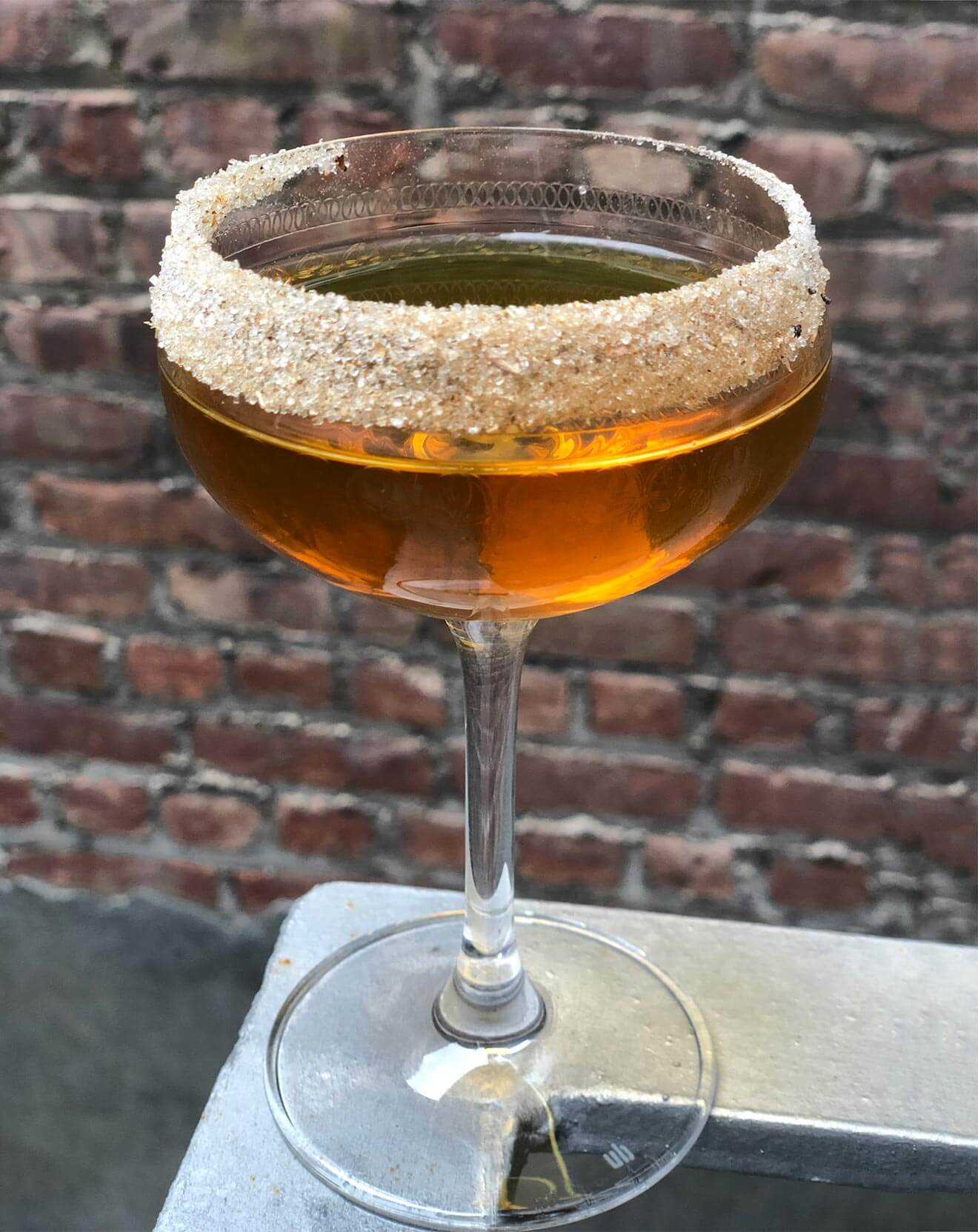 Fir Trade, cocktail with garnish, brick wall
