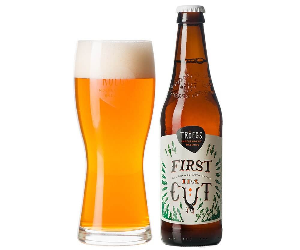 Tröegs Independent Brewing First Cut Mango IPA, glass and bottle on white